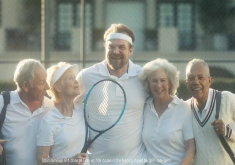 Picture of older men and women playing tennis.